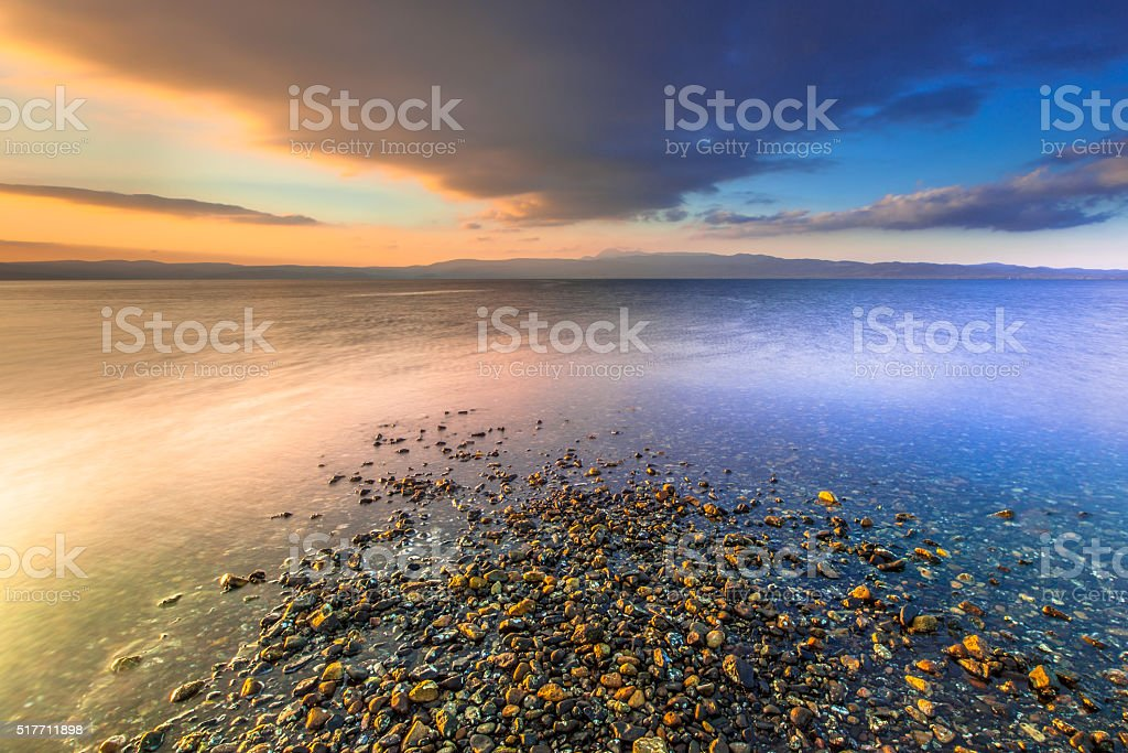 Sunrise over a river mouth on an Aegean island stock photo