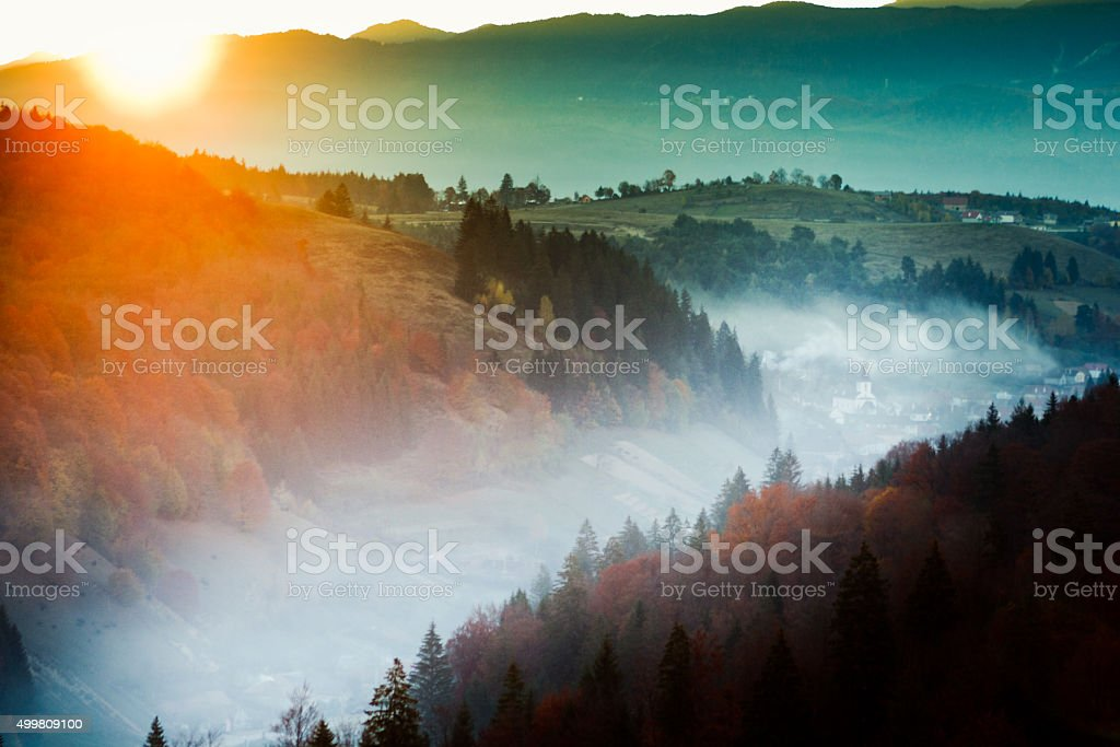 Sunrise over a Romanian village stock photo