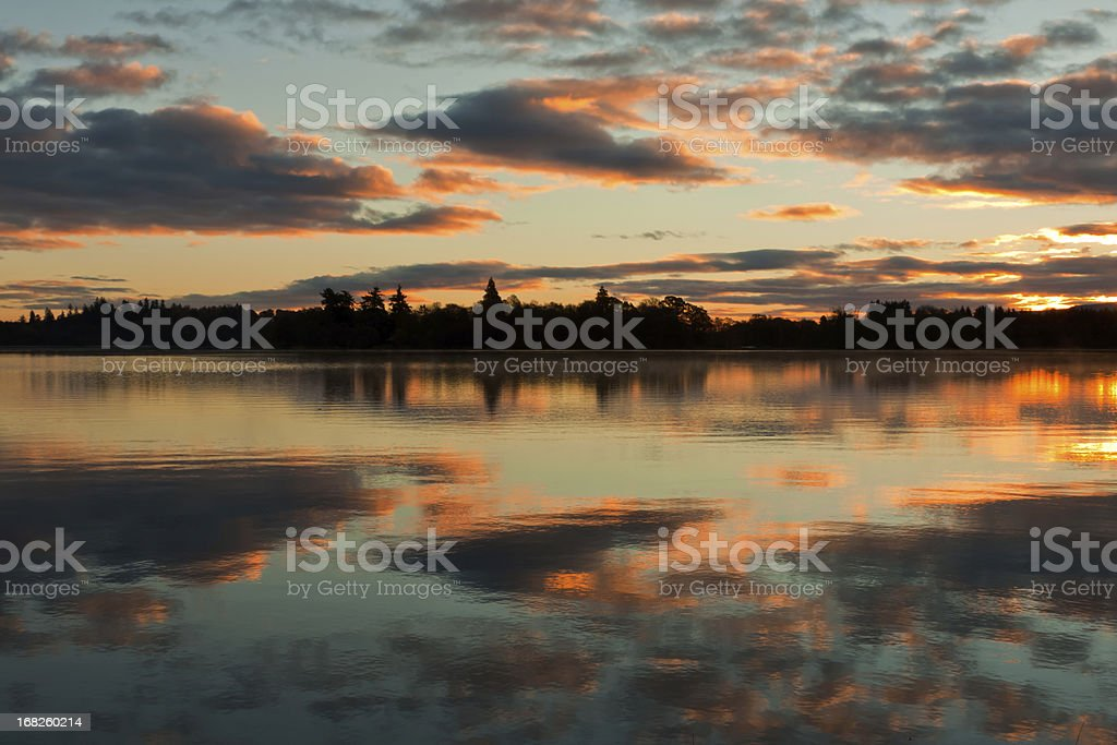 Sunrise over a tranquil Scottish loch. royalty-free stock photo