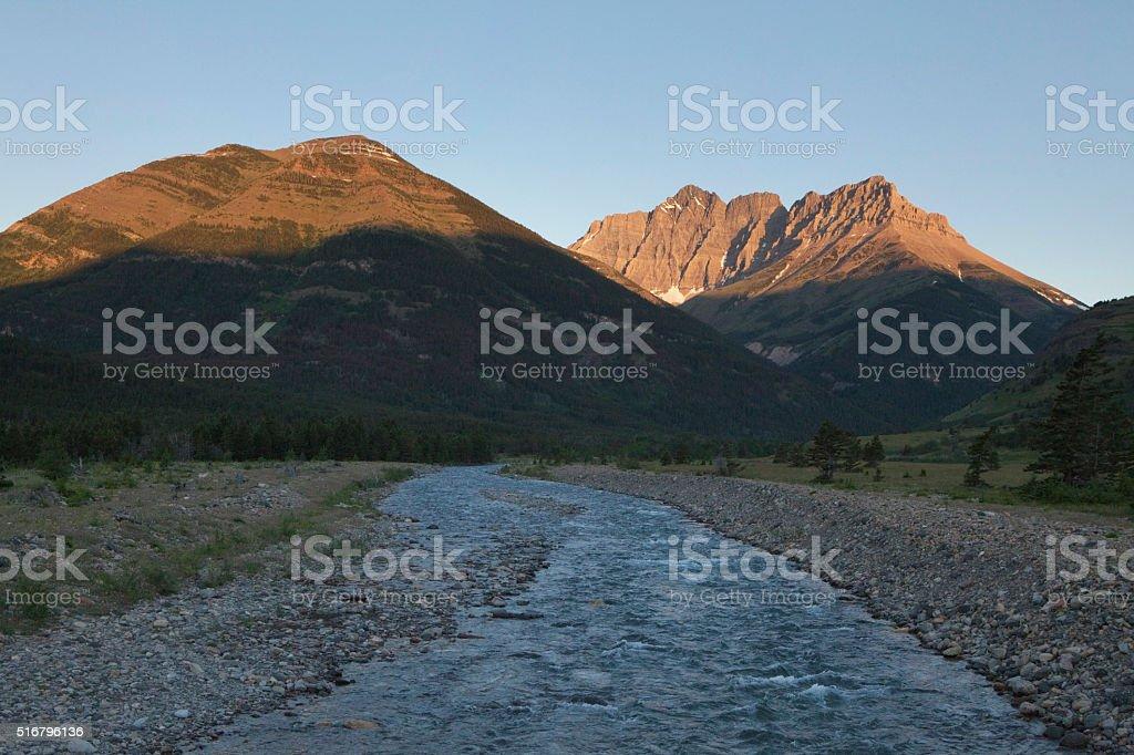 Sunrise over Alberta Canada mountains Mount Blakiston and creek stock photo