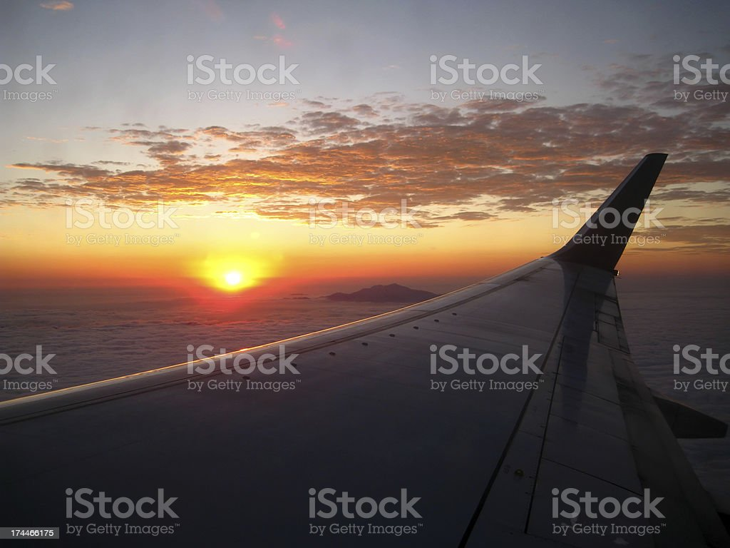 Sunrise over an Airplane Wing royalty-free stock photo