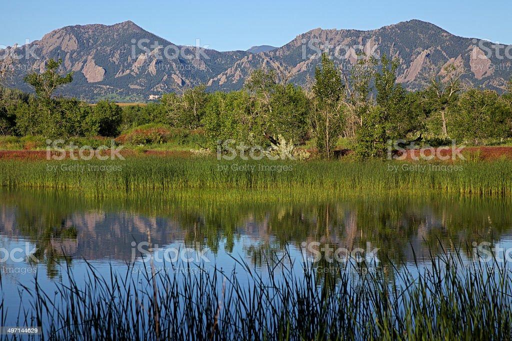 Sunrise Over Boulder Colorado Flatirons Reflecting in Pond stock photo