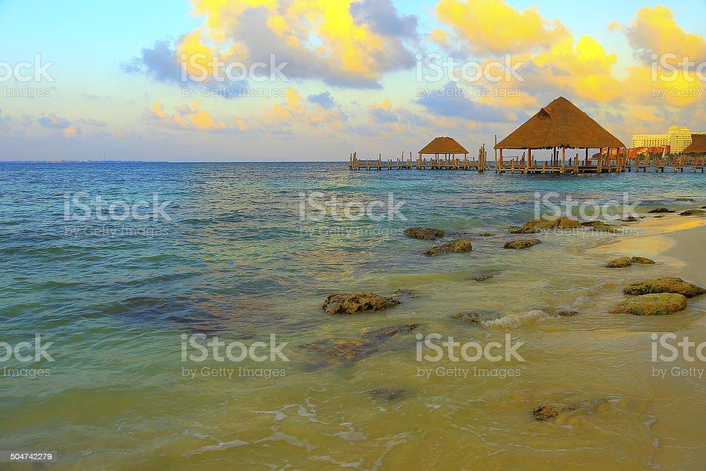 Sunrise over caribbean beach and gazebo - palapa - Cancun stock photo