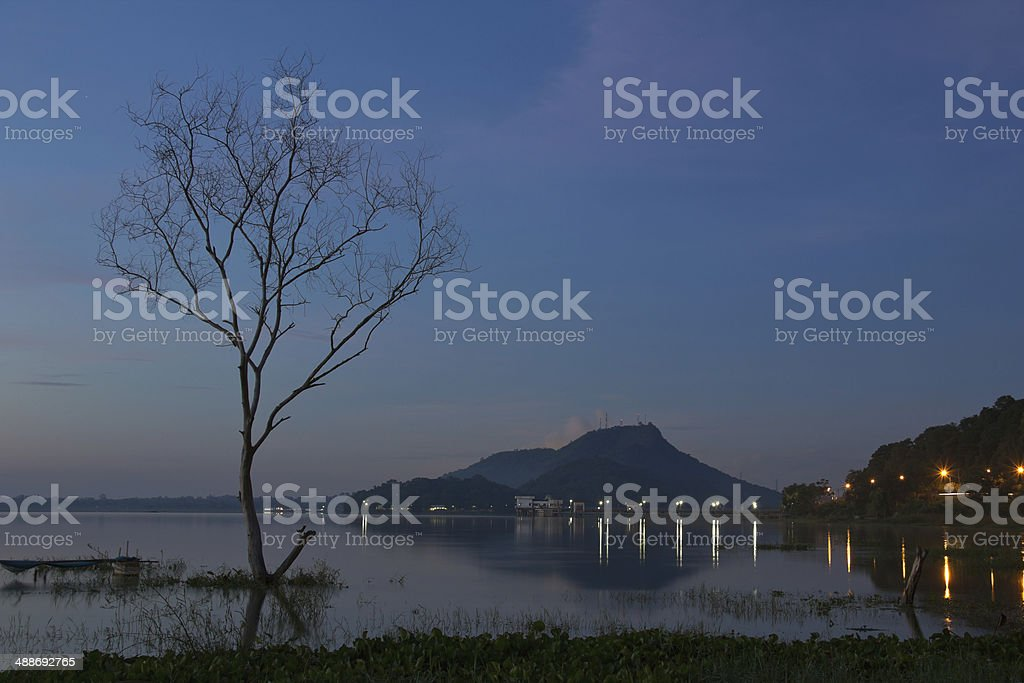 Sunrise over dam with dead trees , at Thailand stock photo