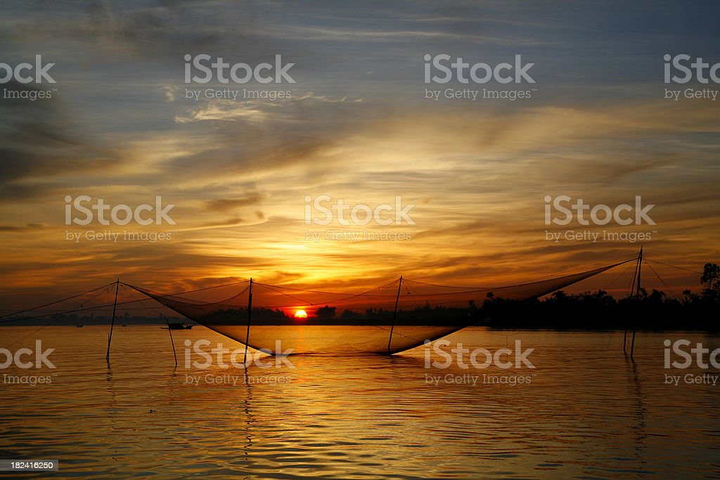 Sunrise over fishing nets stock photo