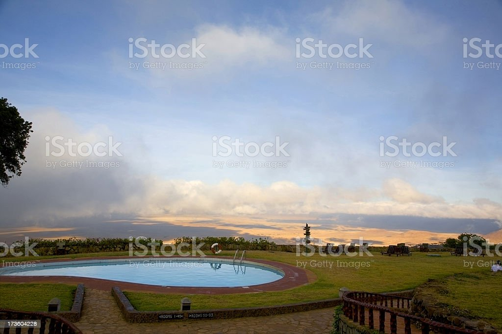 Sunrise over hotel pool. stock photo