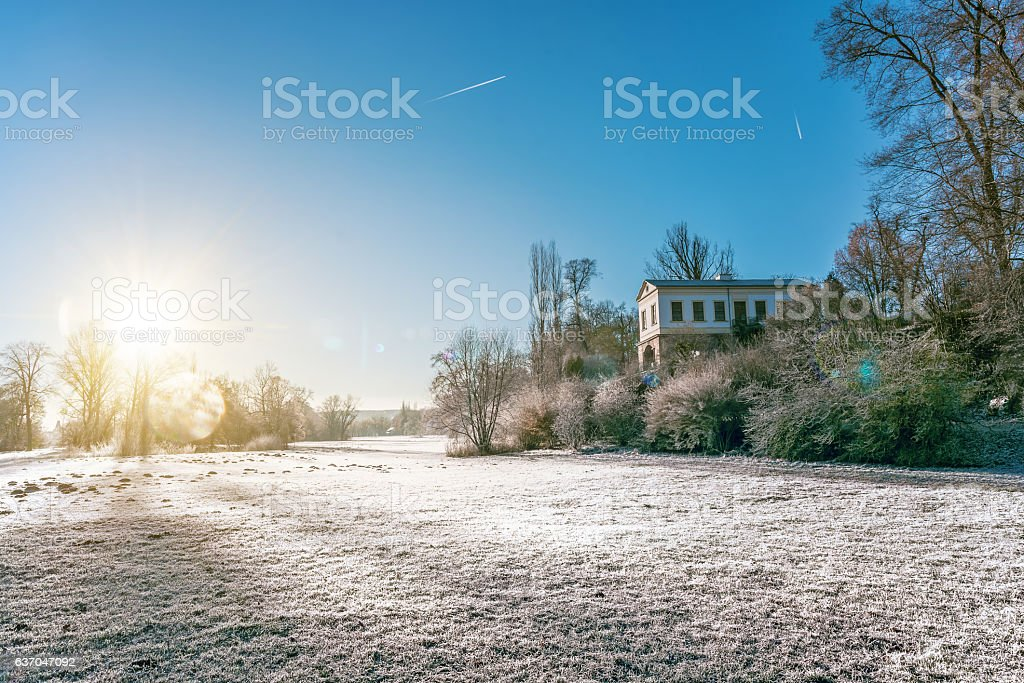 sunrise over Ilmpark in Weimar with Romanian House in winter stock photo