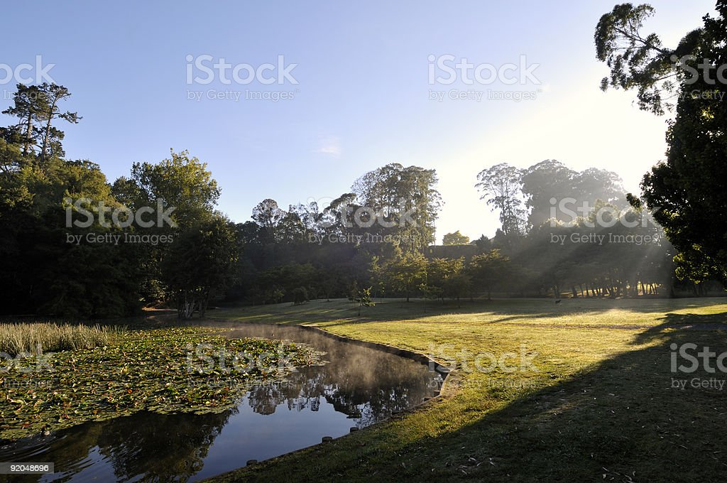 Sunrise over lake and park royalty-free stock photo