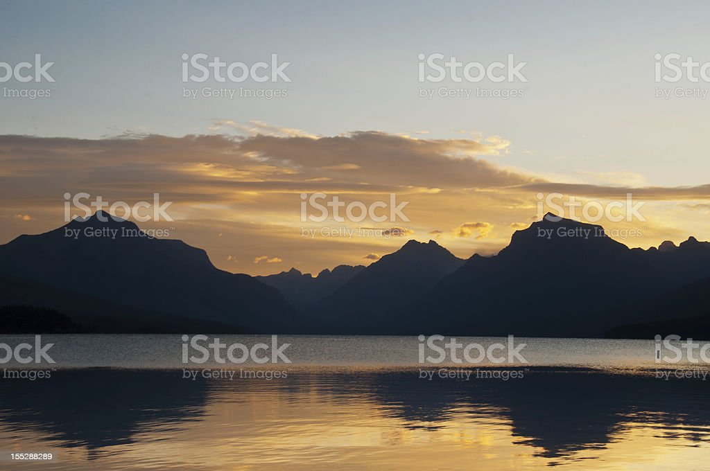 Sunrise Over Lake with Mountain Reflection royalty-free stock photo