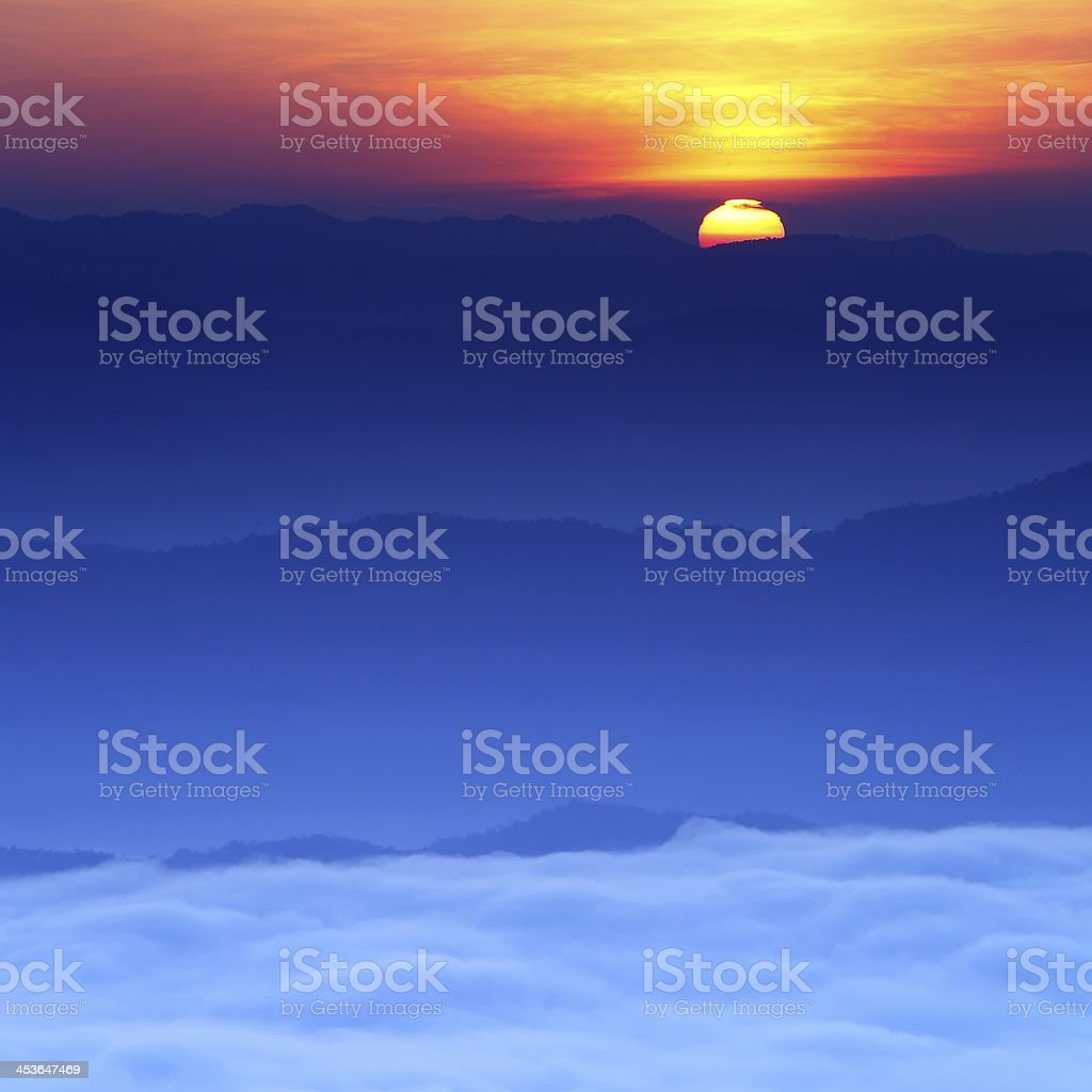 Sunrise over mist with mountains royalty-free stock photo