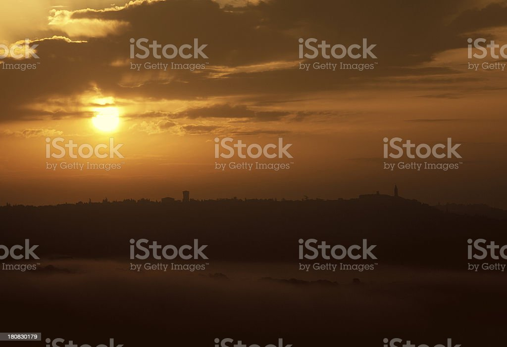 Sunrise over Misty Hills and Hilltop Town of Pienza, Tuscany royalty-free stock photo