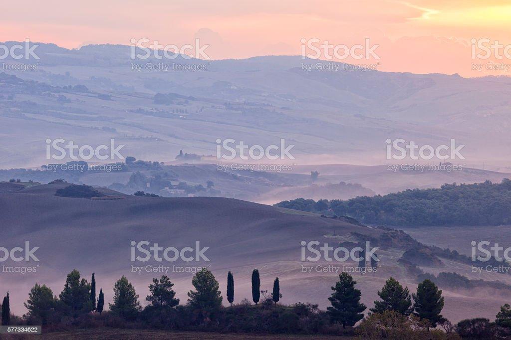 Sunrise Over Misty Landscape, Tuscany, Italy stock photo
