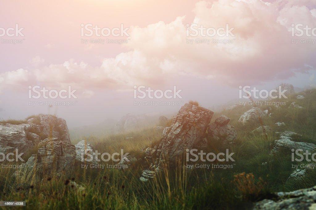 Sunrise over misty valley stock photo