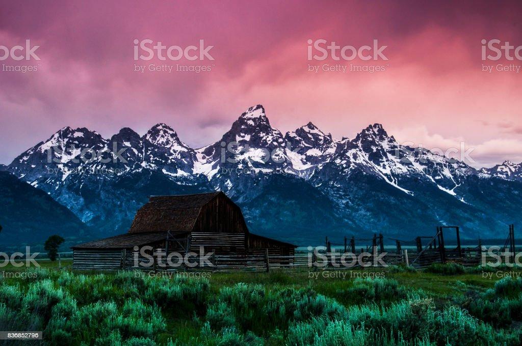 Sunrise over Moulton Barn in Grand Teton National Park stock photo