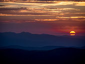 Sunrise over mountains with twilight sky