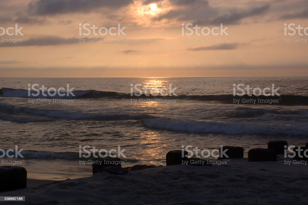 Sunrise Over Pier at the Beach stock photo