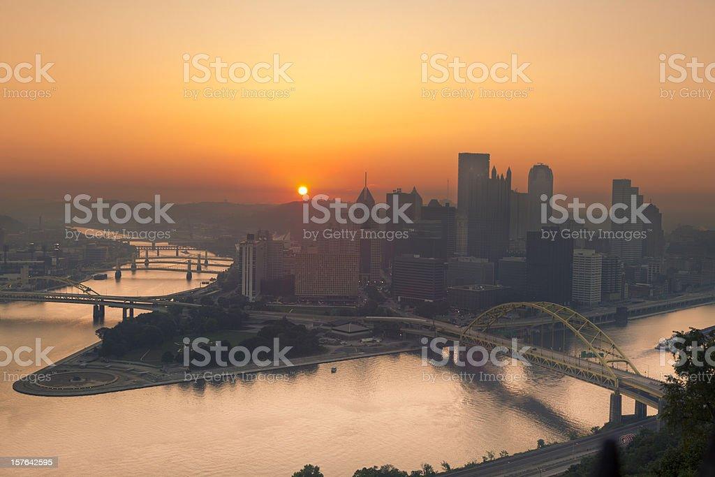 Sunrise over Pittsburgh Illuminates Sky in Orange From Summer Haze royalty-free stock photo