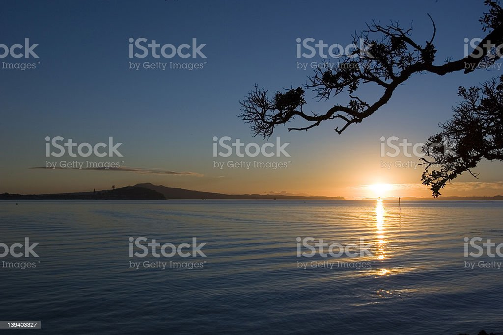 Sunrise over Rangitoto Island in New Zealand stock photo