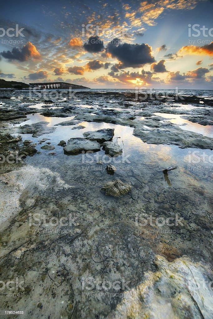 Sunrise over reef island. stock photo
