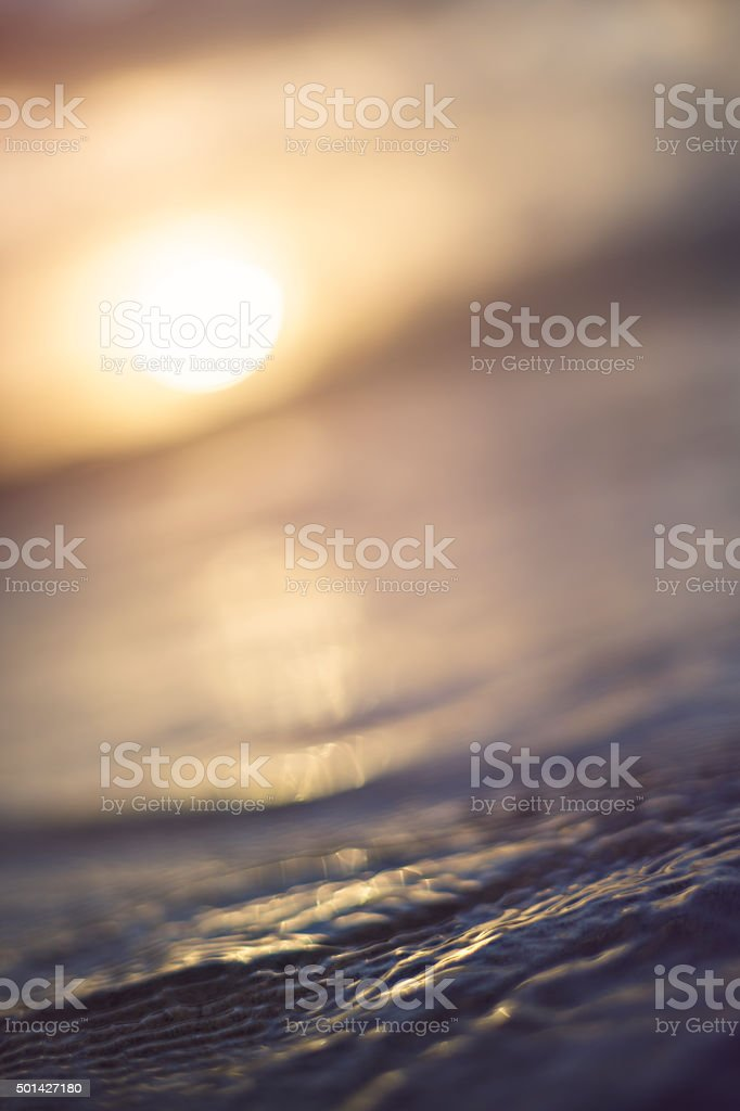 Sunrise over rippled water, cornwall stock photo