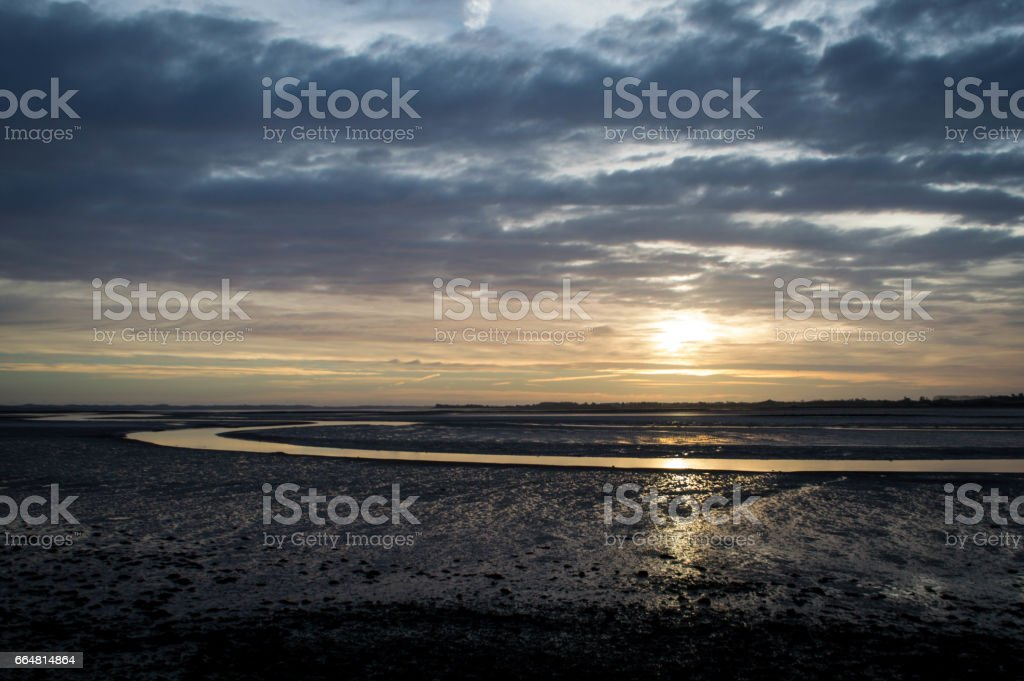 Sunrise over river estuary stock photo