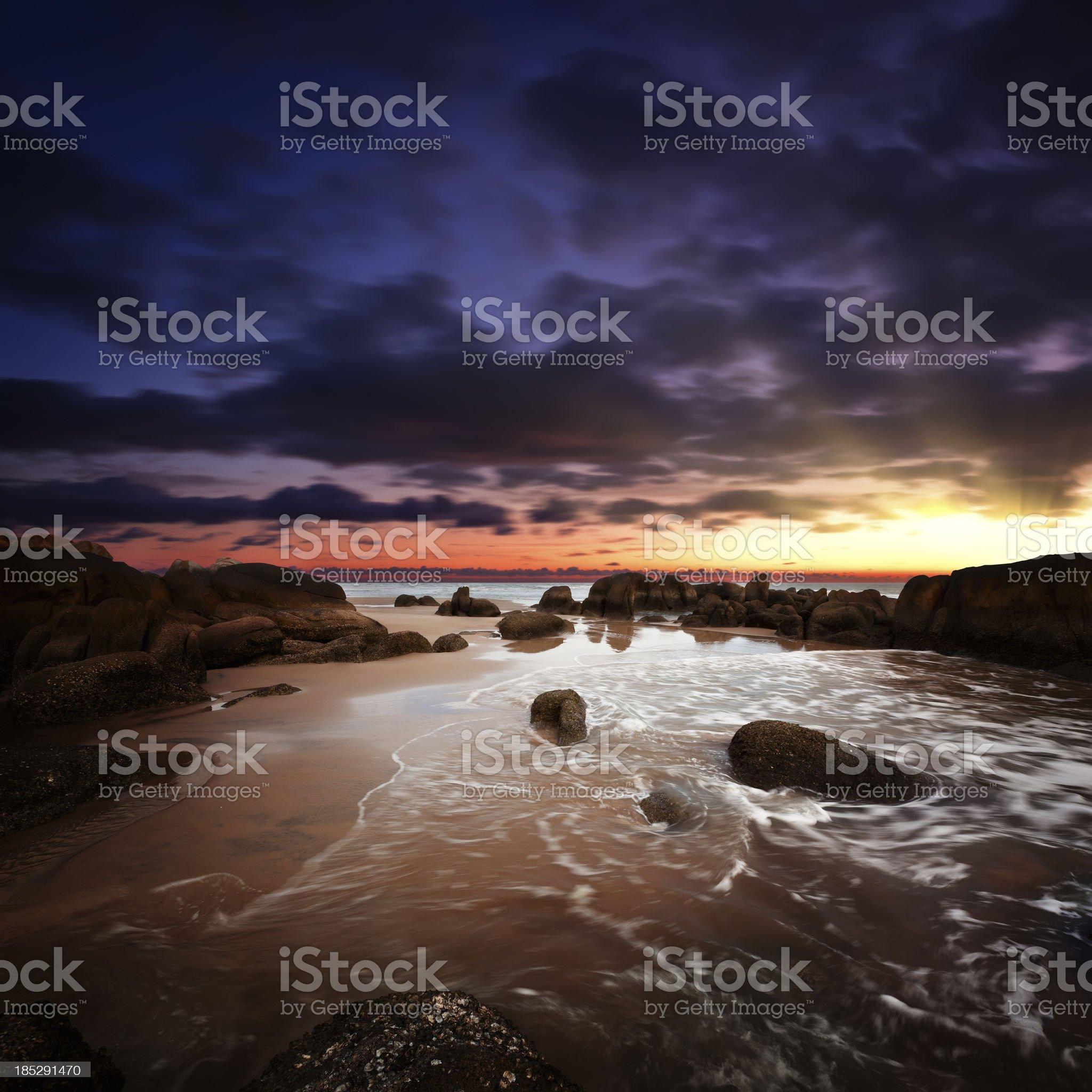 Sunrise over rocky coast royalty-free stock photo