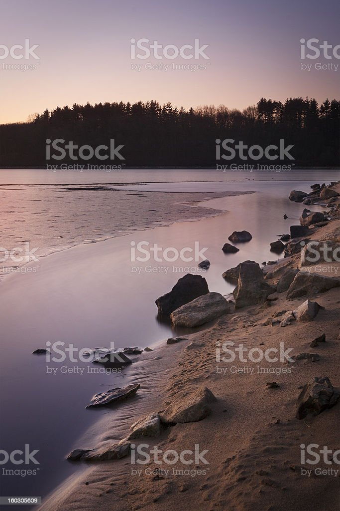 Sunrise Over Rocky Lake Shore royalty-free stock photo