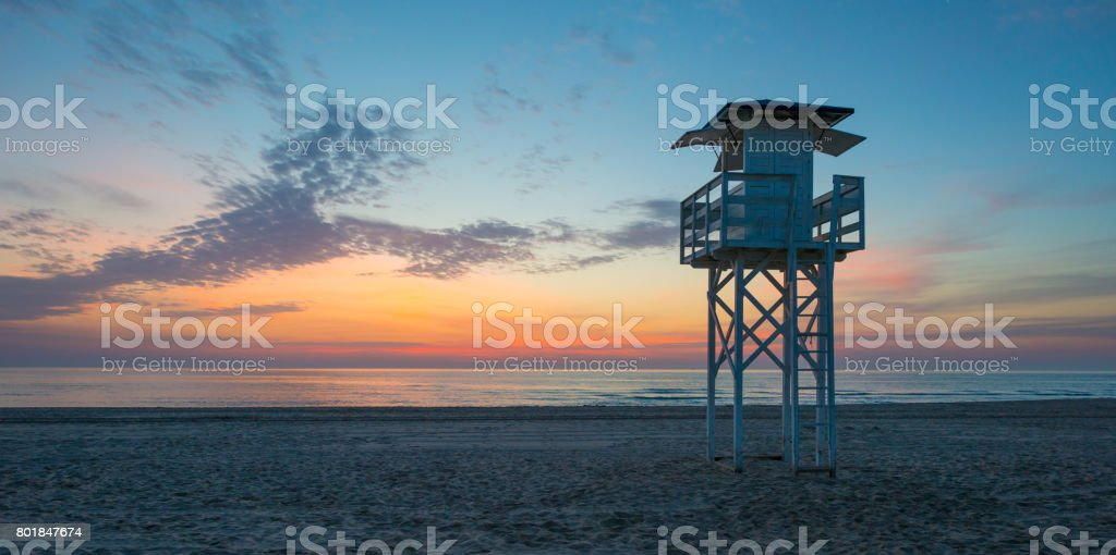Sunrise over sea and sandy beach in spring stock photo