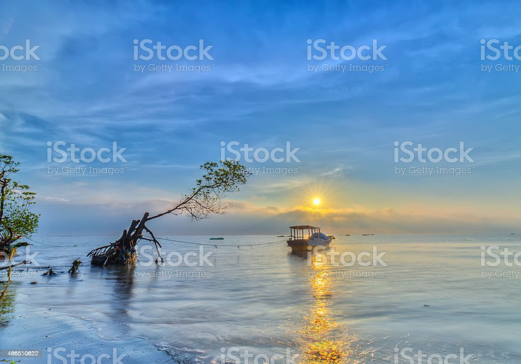 Sunrise over sea Go Cong, Tien Giang, Vietnam stock photo