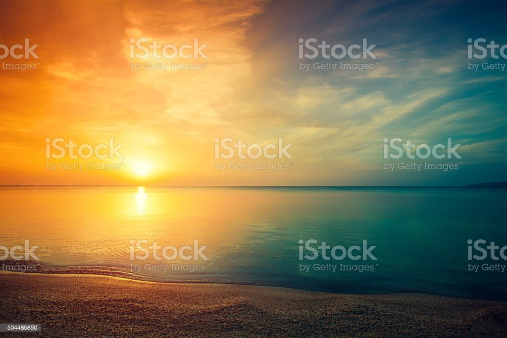 Sunrise over sea stock photo