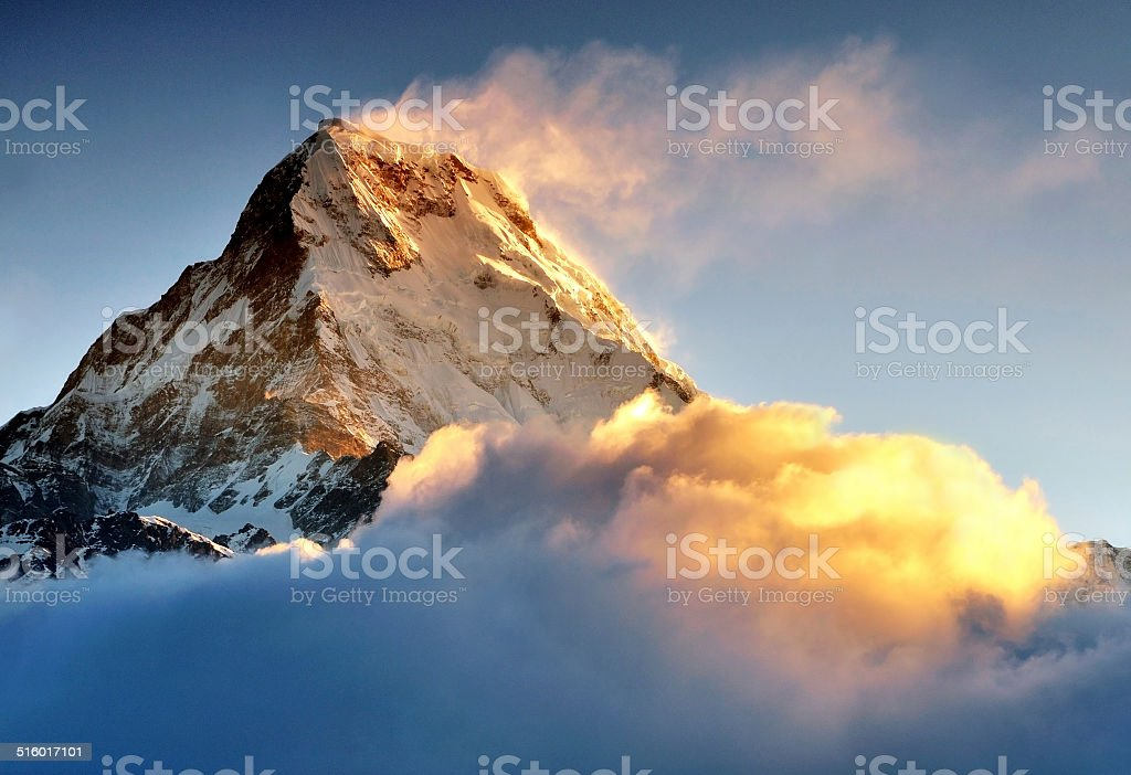 Sunrise over Snow capped mountain Machapuchare, Annapurna Himalaya stock photo