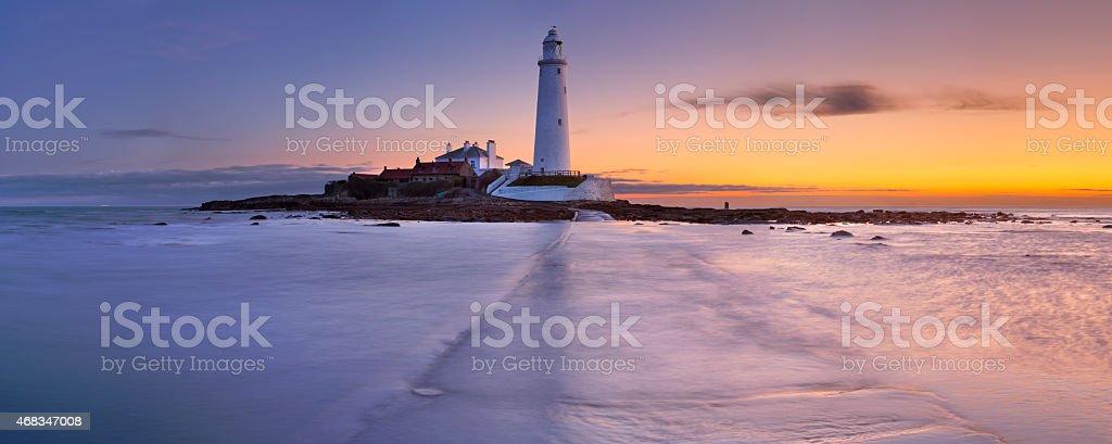 Sunrise over St. Mary's Lighthouse, Whitley Bay, England stock photo