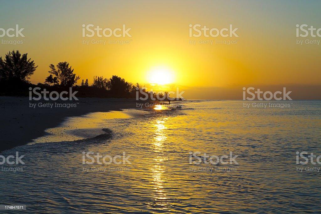 Sunrise over subtropical island stock photo