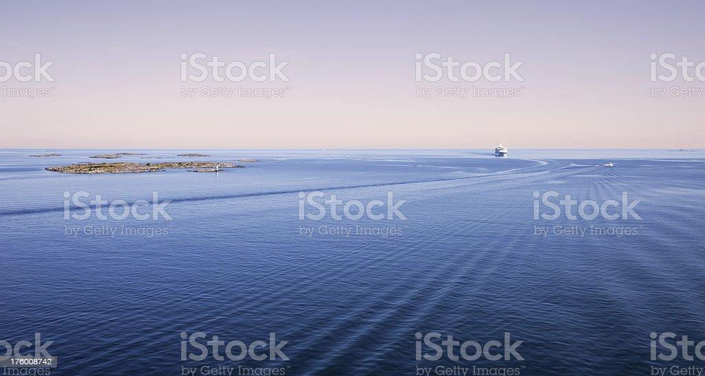 Sunrise over the Baltic sea with cruise ship on horizon stock photo