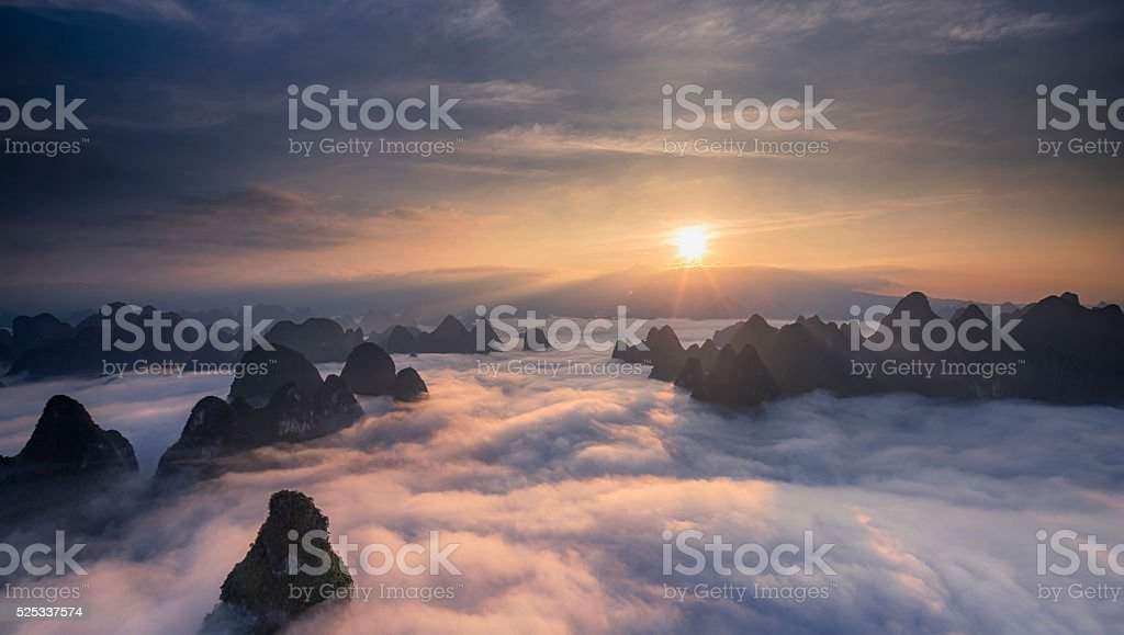 Sunrise over the clouds stock photo