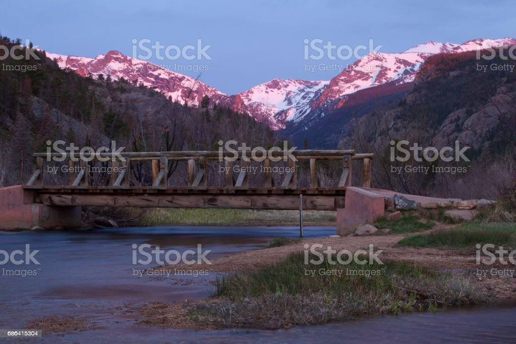 Sunrise over the Continental Divide with The Big Thompson River flowing in the foreground stock photo
