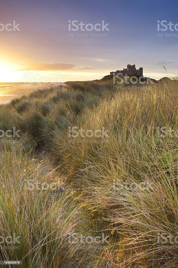Sunrise over the dunes at Bamburgh Castle, Northumberland, England stock photo