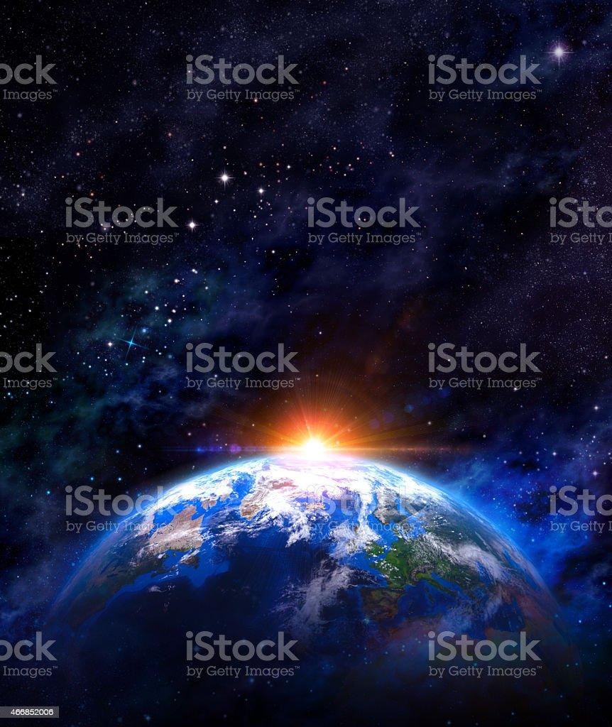 Sunrise over the Earth stock photo
