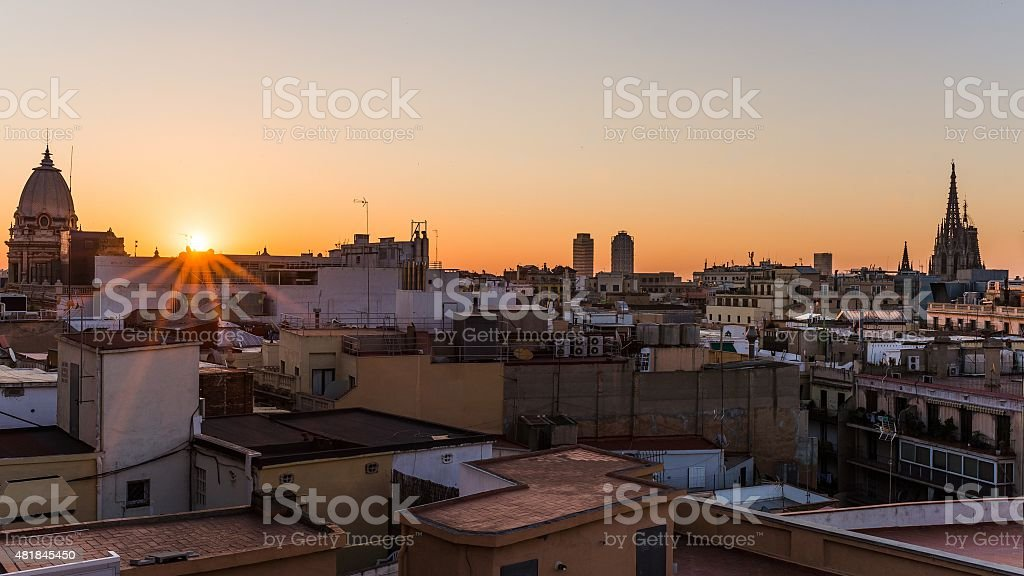 sunrise over the houses of barcelona stock photo