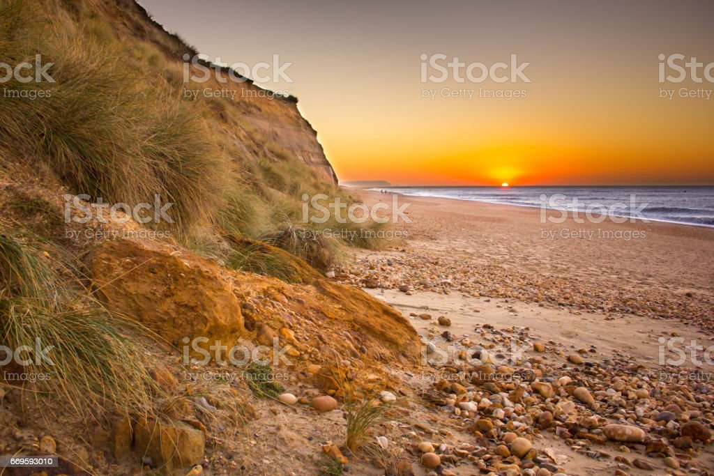 Sunrise over the Isle of Wight as seen from Hengistbury Head stock photo