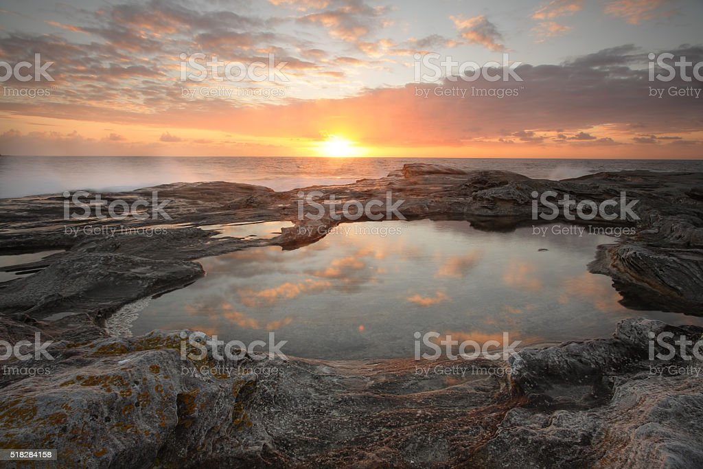 Sunrise over the ocean to Yena Bay stock photo