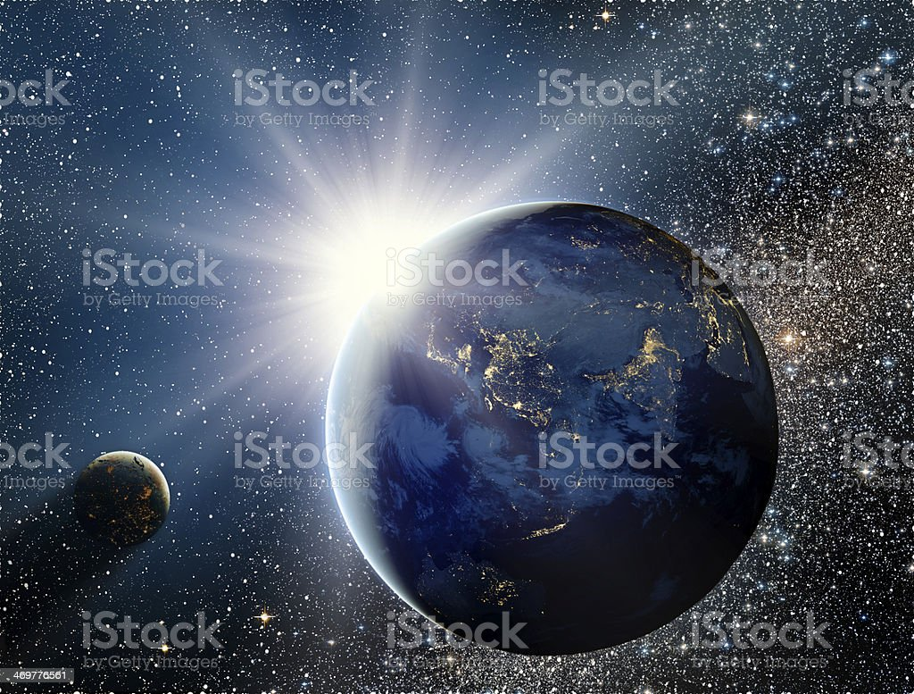 Sunrise over the planet and satellites in space. stock photo