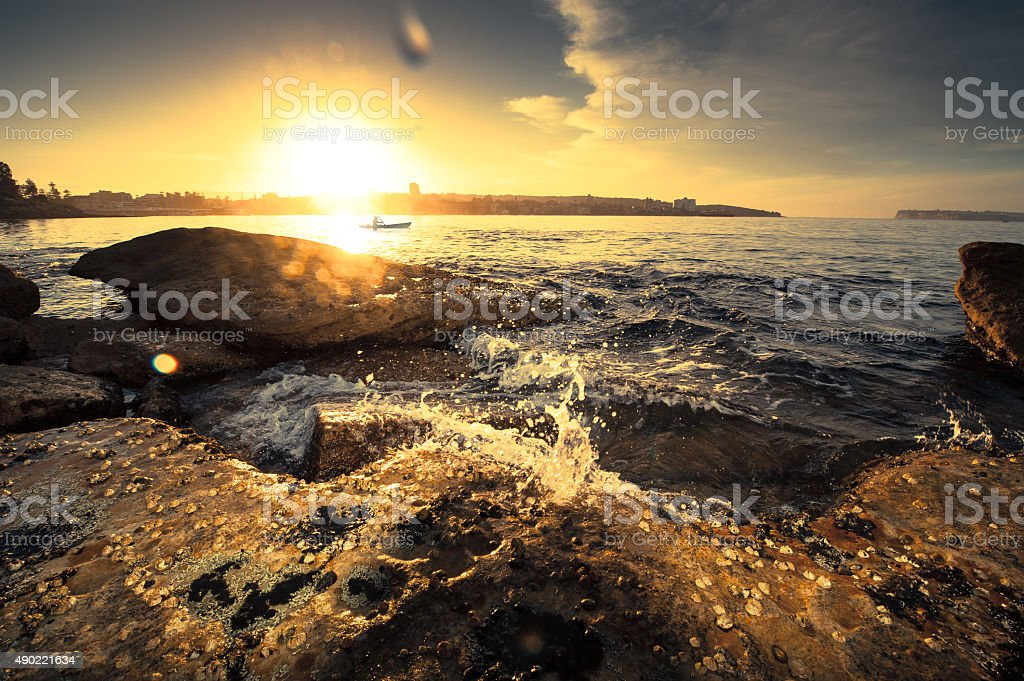 Sunrise over the rocks at Manly Australia stock photo