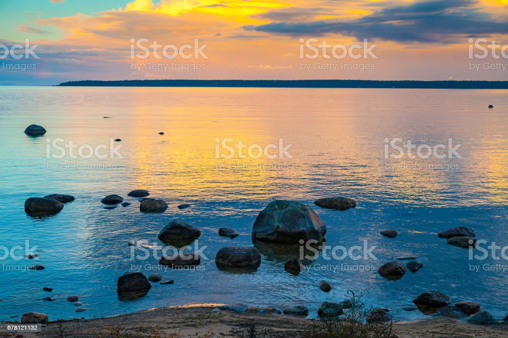 Sunrise over the sea. Stone on the foreground stock photo