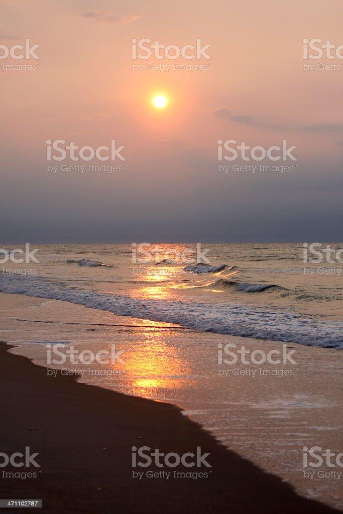 sunrise over the surf stock photo
