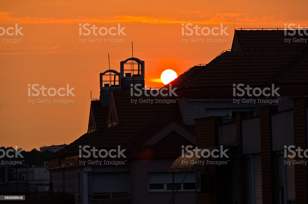 Sunrise over the top of a building roof in Belgrade stock photo