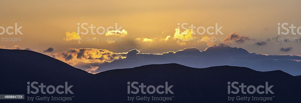 sunrise over the volcanic mountains seen fromPlaya Blanca royalty-free stock photo