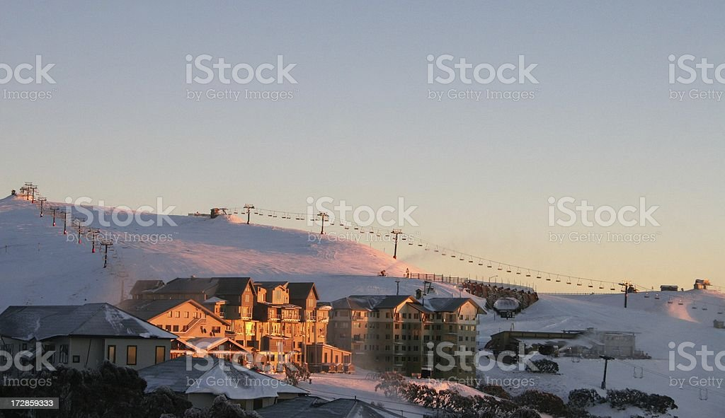 Sunrise over village in the snow royalty-free stock photo