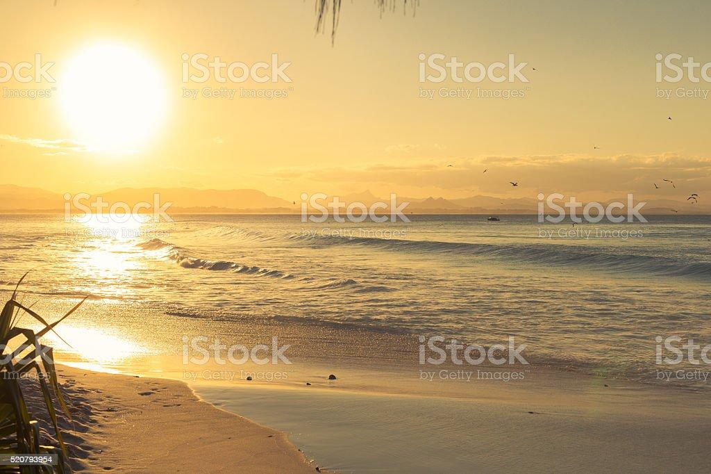 Sunrise over Watego's Beach at Byron Bay stock photo