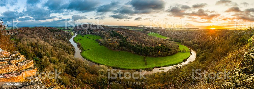 Sunrise panorama over idyllic meandering forest river valley Symonds Yat stock photo